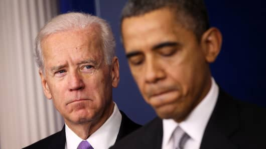 President Barack Obama speaks as Vice President Joseph Biden listens during an announcement on gun reform on December 19, 2012.