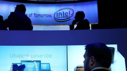 Attendees inspect Intel UltraBooks during