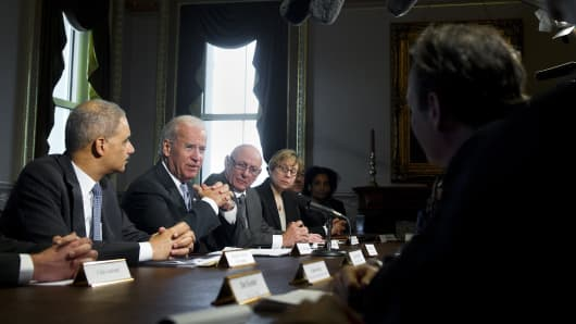 Vice President Joe Biden speaks alongside Attorney General Eric Holder (L) as he meets with representatives of victims' groups and gun safety organizations.