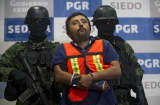 Mexican Army soldiers escort Luis Jesus Sarabia Ramon (C), aka 'El Pepito' or 'Z-44', an alleged leader of Los Zetas