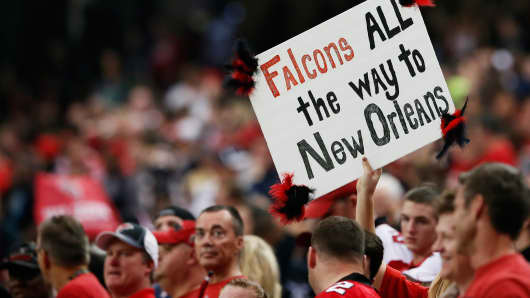 An Atlanta Falcons fan holds up a sign during the NFC Divisional Playoff Game against the Seattle Seahawks at Georgia Dome on January 13, 2013 in Atlanta, Georgia.