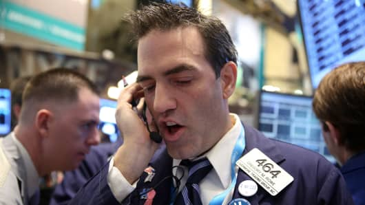 A trader with Livermore Trading Group Inc., works at the New York Stock Exchange (NYSE) in New York, U.S.