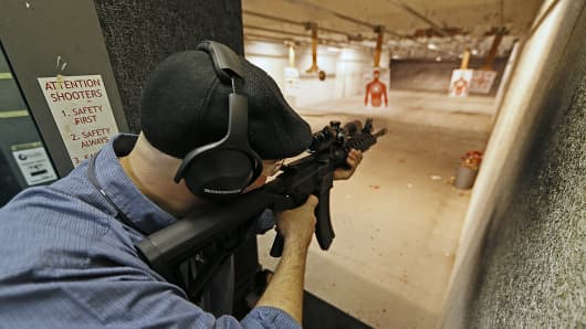 A man fires an 22 Cal. look-alike AR-15 rifle at the 'Get Some Guns & Ammo' shooting range on January 15, 2013 in Salt Lake City, Utah