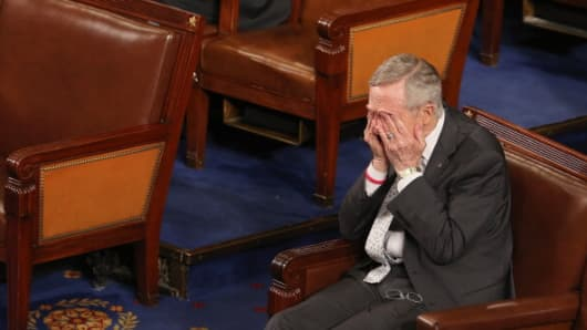 Senate Majority Leader Harry Reid, D-Nev., rubs his eyes during the counting of Electoral College votes in the House.