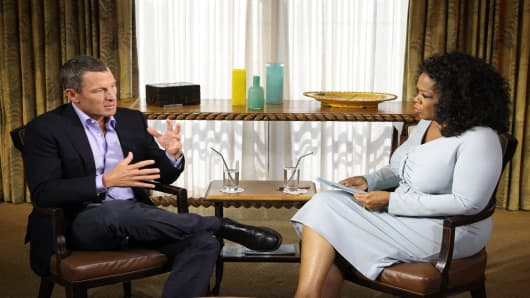 Oprah Winfrey speaks with Lance Armstrong during an interview regarding the controversy surrounding his cycling career January 14, 2013 in Austin, Texas.