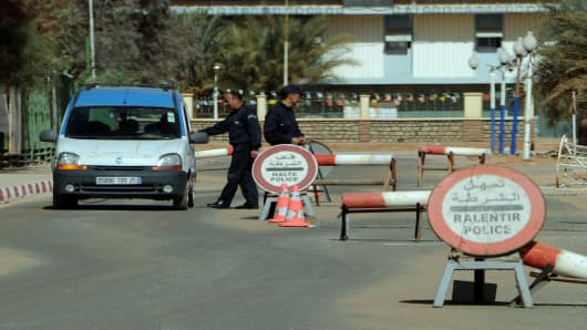 Algerian policemen stop cars at a checkpoint in In Amenas, deep in the Sahara near the Libyan border.