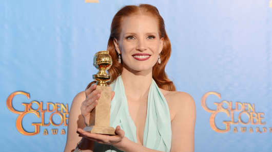 Jessica Chastain poses after winning the Best Actress Golden Globe Award for her role in Zero Dark Thirty.