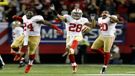 The San Francisco 49ers react after stopping the Atlanta Falcons on fourth down in the fourth quarter in the NFC Championship game at the Georgia Dome on January 20, 2013 in Atlanta, Georgia