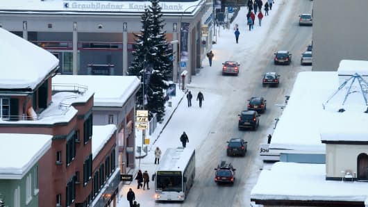 Traffic and pedestrians walk down the main thoroughfare in Davos, Switzerland.
