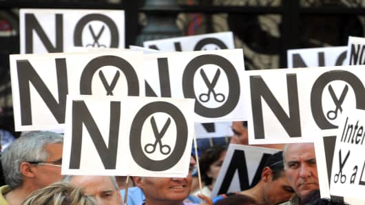 Government employees demonstrate against the Spanish government's latest austerity measures.