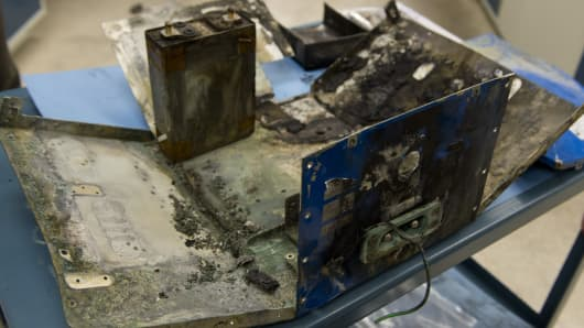 The damaged battery case from a fire aboard a Japan Airlines (JAL) Boeing 787 Dreamliner airplane at Logan International Airport in Boston is displayed inside an investigation lab at National Transportation Safety Board (NTSB) Headquarters in Washington, DC.