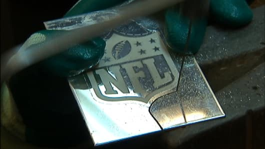 Tiffany & Co. shows off the NFL insignia on the Super Bowl Trophy.