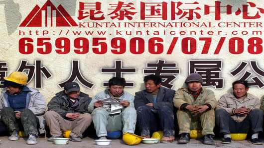 A group of Chinese migrant workers rest