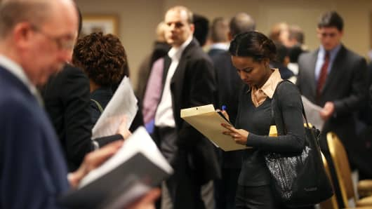 Applicants wait to meet potential employers at a Manhattan job fair in New York City.