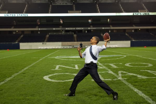 U.S. President Barack Obama throws a football at Soldier Field following the NATO Summit working dinner on May 20, 2012 in Chicago, Illinois.