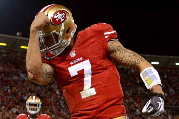 Colin Kaepernick of the 49ers celebrates after a touchdown against the Green Bay Packers during the NFC Divisional Playoff Game at Candlestick Park on January 12, 2013.