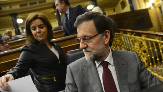 Spanish Prime Miniister Mariano Rajoy (R) attends a Parliament session in Madrid. Anger over a long list of corruption scandals implicating bankers, politicians and even members of the royal family.