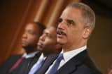 U.S. Attorney General Eric Holder leads a news conference with Acting Associate Attorney General Tony West, Princip