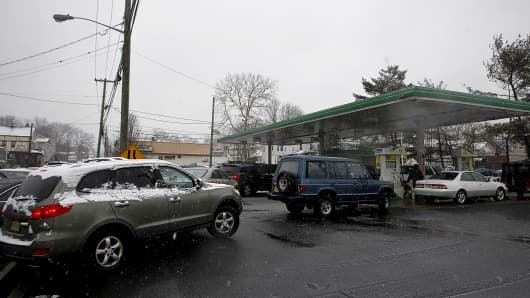 Customers line up to fill up fuel tanks at a gas station Friday in Vauxhall, N.J.