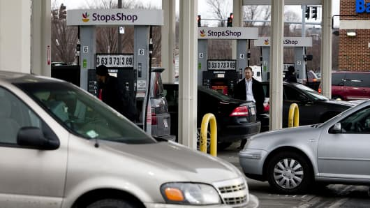 Customers line up to fill up fuel tanks at the Stop and Shop gas station in Boston, Massachusetts, U.S., on Friday, Feb. 8, 2013.