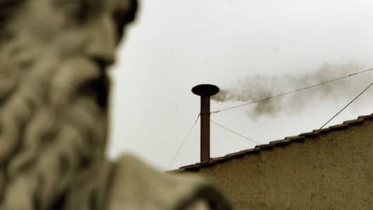 Black smoke is seen from the roof of the Sistine Chapel.