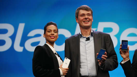 BlackBerry President and CEO Thorsten Heins (R) stands with new BlackBerry Global Creative Director Alicia Keys.