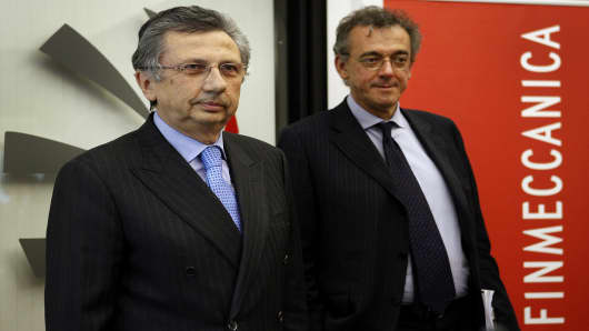 Giuseppe Orsi, chief executive officer of Finmeccanica SpA, left, and general manager Alessandro Pansa