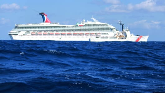 The cruise ship Carnival Triumph sits idle February 11, 2013 in the Gulf of Mexico. According to the Coast Guard, the ship lost propulsion power February 10, after a fire broke out in the engine room.