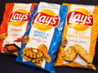 Lays introduces their new chip flavors: sriracha, chicken and waffles, and cheesy garlic bread.