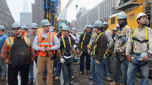 Workers gather at a groundbreaking ceremony for the Hudson Yards development.