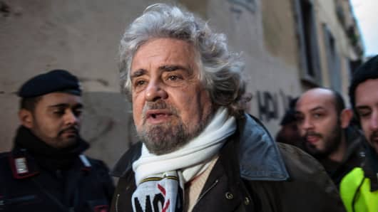 Beppe Grillo, founder of the Movimento 5 Stelle (Five Star Movement), arrives to speak during a public rally for the political campaign on January 23, 2013 in Pomezia, Italy.