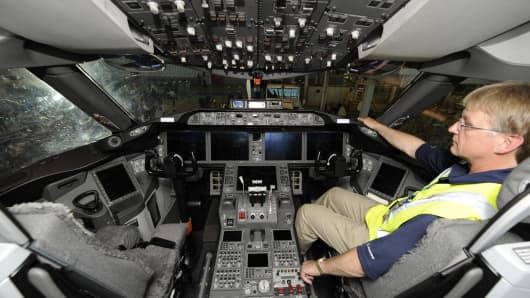 A flight test engineer of Boeing sits on 787 Dreamliner cockpit.