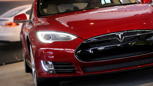 A Tesla Motors Inc. vehicle is displayed during the 2013 North American International Auto Show (NAIAS) in Detroit, Michigan, U.S.