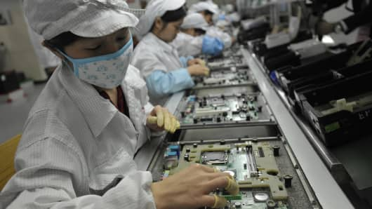 Chinese workers in the Foxconn factory in Shenzhen, in southern China's Guangdong province.