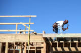 A construction worker uses a hammer at a new housing development in San Mateo, California.