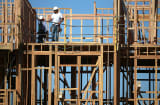 Construction workers are seen on the job at a new housing development in San Mateo, California.