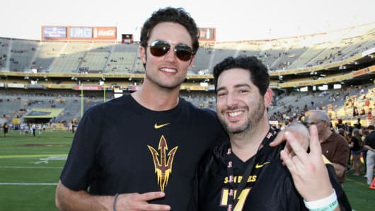 Former ASU quarterback Brock Osweiler, pictured at far left, and fan Jonathan Leiterman, who used startup Fandeavor.