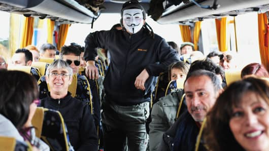 Supporters and activists from Livorno of the Movimento 5 Stelle, Five Star Movement go by bus to attend the last polit