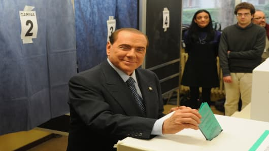 Former Italian Prime Minister Silvio Berlusconi casts his vote in a polling station on February 24, 2013 in Milan, Italy.