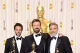 Grant Heslov, Ben Affleck, and George Clooney, winners of the Best Picture award for 'Argo,' pose in the press room during the Oscars.