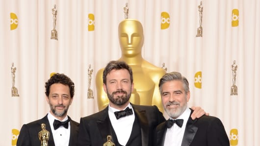 Grant Heslov, Ben Affleck, and George Clooney, winners of the Best Picture award for 'Argo,' pose in the press room during the Os