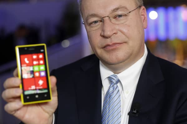 Stephen Elop, chief executive officer of Nokia Oyj, poses for a photograph with a Lumia smartphone at the Mobile World Congress in Barcelona, Spain.