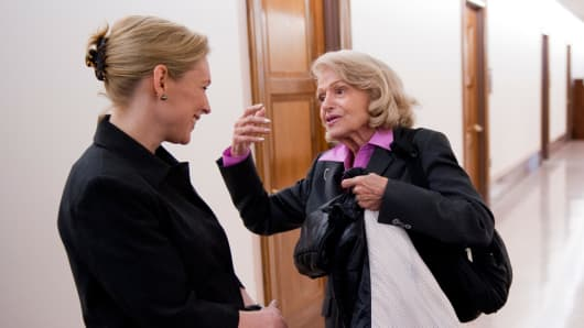 Sen. Kirsten Gillibrand, D-N.Y., and Edith Windsor, of New York City, talk in the hall before a news conference on the bill Gillibrand and other senators are sponsoring that would repeal the Defense of Marriage Act (DOMA).