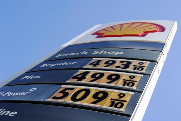 Gas prices over four and five dollars are posted on a Shell station on Olympic Boulevard in Los Angeles, California.