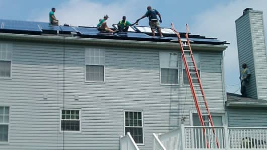 SolarCity installs solar panels on a home.