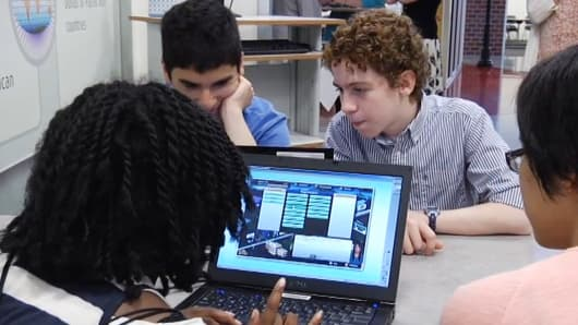 Students play JA Virtual Finance Park video game in school.