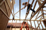 A worker builds a new home at the Pulte Homes Fireside at Norterra-Skyline housing development in Phoenix, Arizona.