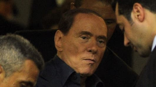 Silvio Berlusconi attends a football match between AC Milan and Juventus FC.