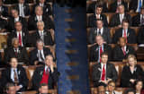 Members of each party sit mixed during President Barack Obama's State of the Union address to a joint session of the U.S. Congress.