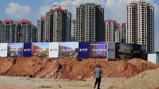 Empty apartment developments stand in the city of Ordos, Inner Mongolia.